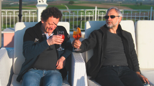Two men drinking cocktails | Hotel Villa Sevasti